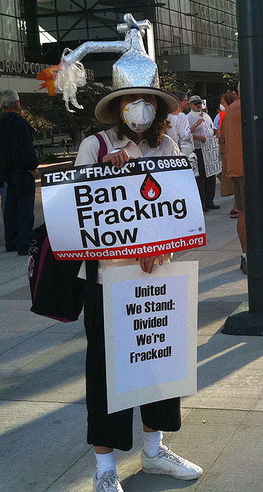 protester at EPA rally with frack hat.
